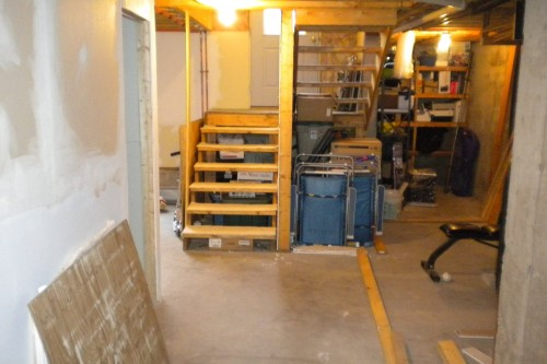cluttered unfinished waterbury basement before start of allied contractors remodeling project