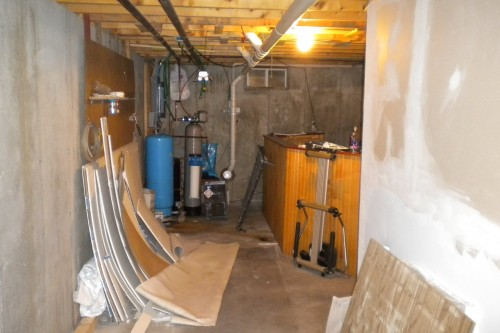 unfinished waterbury basement before remodeling project start by allied contractors