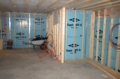 waterbury basement without drywall with green insulation during remodeling project