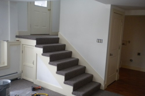 short staircase to exterior door in waterbury basement during allied contractors remodeling project