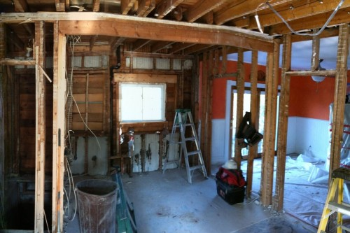 A photo of a Barre kitchen during the remodeling project stripped to studs and without any interior finishing