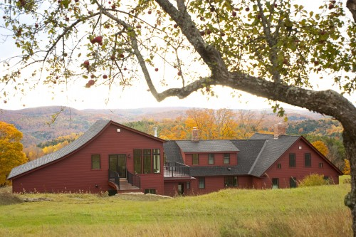 Sprawling red house in central vermont after complete remodeling project by allied building contractors