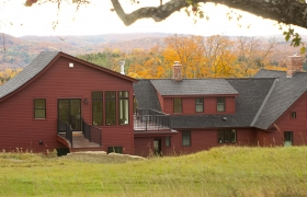 Red sprawling house in central vermont after full remodeling project by Allied Building contractors