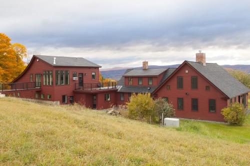 wide view across hill of completely remodeled central vermont home by allied building contractors