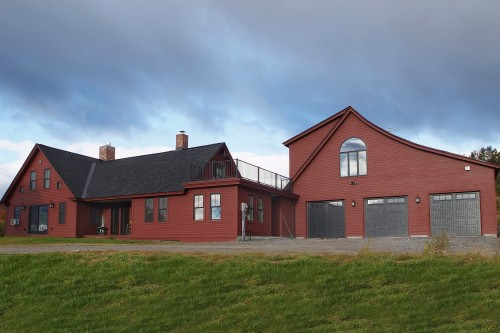 Wide photo of sprawling red central vermont home after completed remodeling project