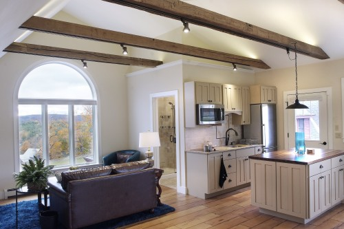 Bright living area and kitchen in central vermont home after complete remodeling project