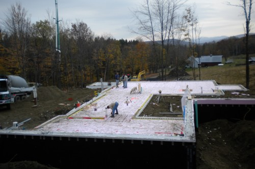 first floor laid out during new home build project in central vermont as allied contractors measure the site