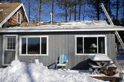 Gray exterior of home in the snow before start of home remodeling project by allied building contractors