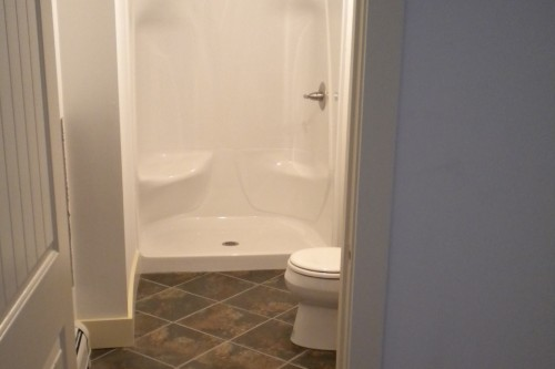 finished basement bathroom remodeling project with shower and tiles by allied contractors