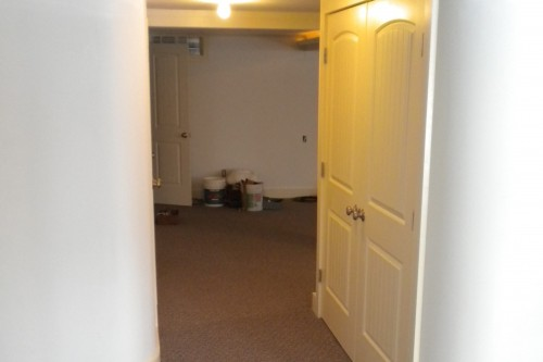 unfurnished carpeted waterbury basement space after completed remodeling project by allied builders