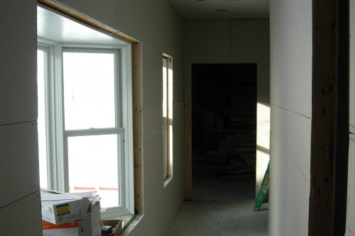 unfurnished hallway during build project by allied contractors