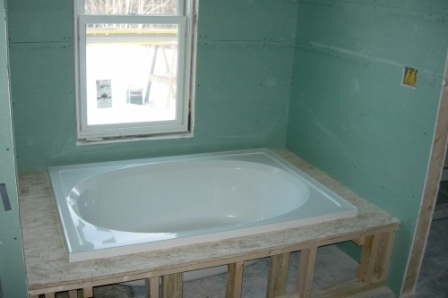 bathroom remodeling tub and green window installation in home build project in central vermont by allied contractors