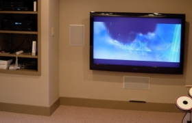 finishedwaitsfield vermont basement after remodeling project with mount tv and built in shelving by allied contractors