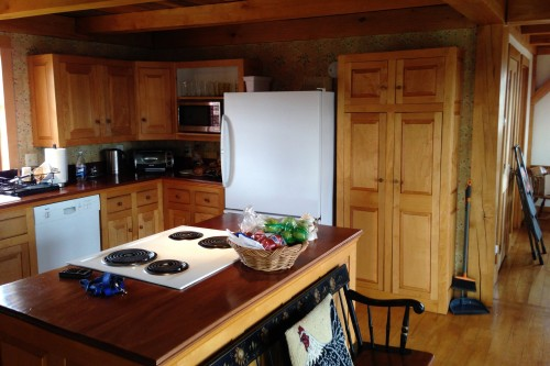 central vermont kitchen with wood cabinets and electric range before kitchen remodeling project by allied contractors