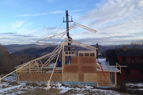 Trusses set up over home during remodeling project in central  vermont