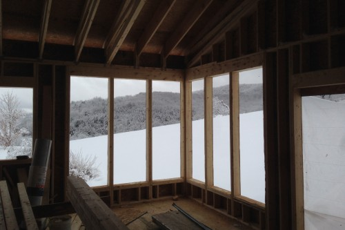 Snowy field from empty complete home remodeling interior