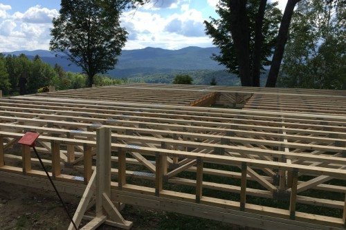 A wooden frame ready to be installed during the full remodel process of central vermont farmhouse