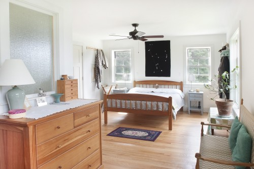 A wide shot of a fully furnished and remodeled bedroom in a central vermont farm house by allied building contractors
