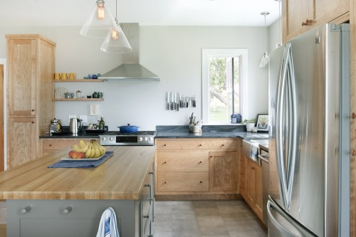 A bright fully remodeled kitchen with modern appliances in renovated central vermont farmhouse