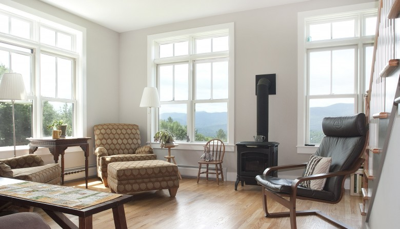 Fully furnished living area after remodel includes energy efficient windows