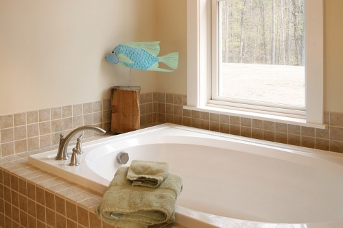Bathroom tub and green efficient window in central vermont home build project by allied contractors