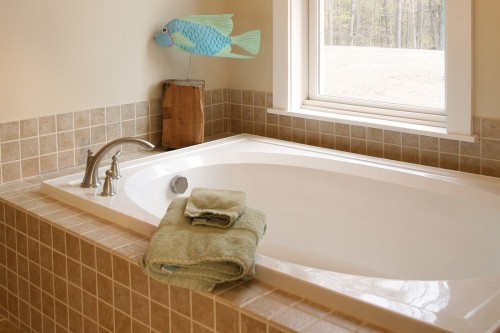 tub and tiled floor after completed bathroom remodeling project in central vermont by allied contractors