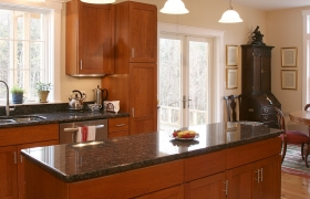 after completed kitchen renovation a large kitchen with black counters and large windows in central vermont