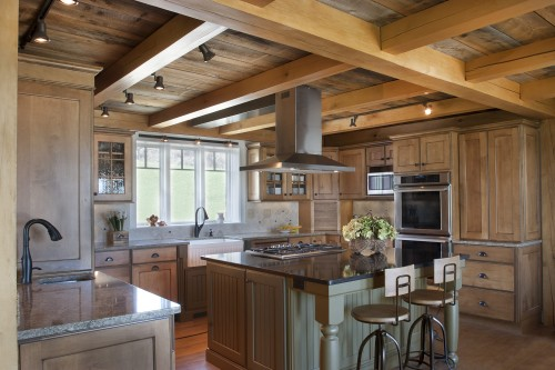 Kitchen with wood cabinets and modern appliances after completion of kitchen remodeling project in central vermont by allied builders