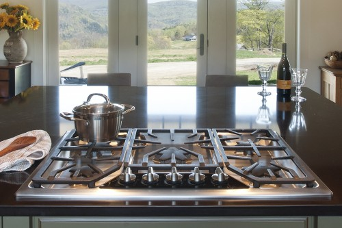 View over stove towards large windows overlooking central vermont hills