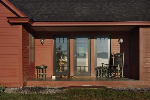 Porch on red central vermont home after completed remodeling project